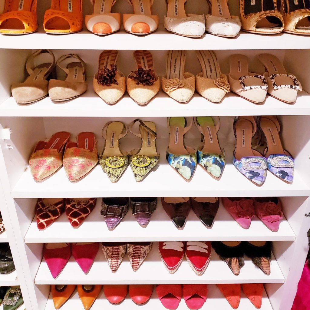 Pretty pumps on a white shelf