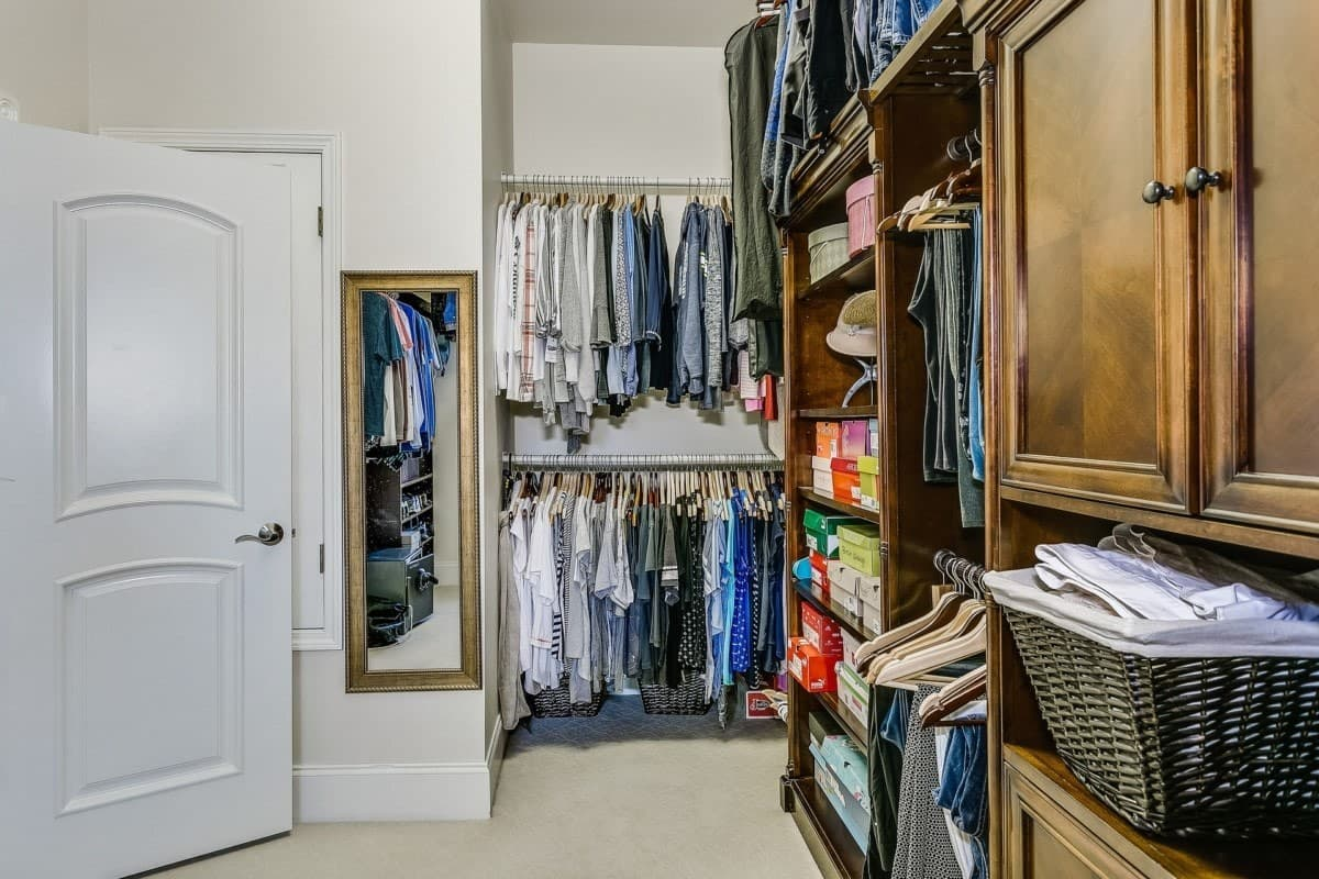 Organized closet with clothes and shoe boxes